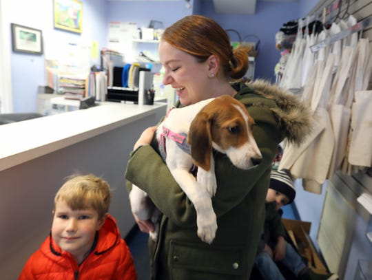 Lili Griffin of Katonah, with hers sons Wes and Will, adopts a dog at SPCA of Westchester's facility in Briarcliff Manor Nov. 15, 2018.