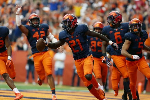 Trill Williams (21), a freshman cornerback at Syracuse University, scores a touchdown during a 62-10 home win over Wagner Sept. 8, 2018. The Yonkers native and Archbishop Stepinac graduate will play at Yankee Stadium Saturday when No. 12 Syracuse meets No. 3 Notre Dame.