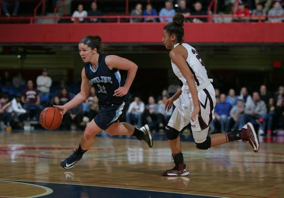 Ursuline's Anna Savino (22) drives around Ossining's Andra Espinoza-Hunter (2) as Ossining and Ursuline play the Girls Class AA Sectional semi-final basketball game on Feb. 28, 2013 at the Westchester County Center in White Plains.