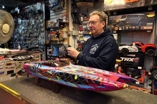 Owner Jason Schaeffer with a remote controlled boat at The Hobby Store in Mount Vernon Nov. 13, 2018. The shop has been around for 15 years.