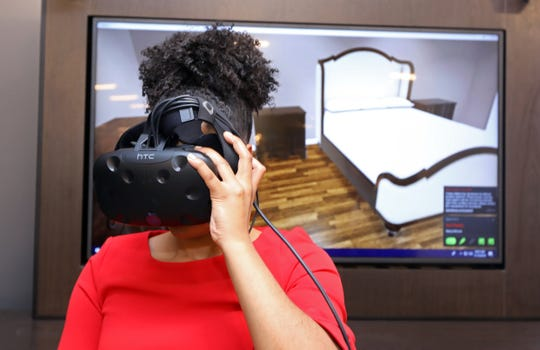 Media relations director Emily Hawkins tries the new virtual reality technology which allows clients to envision the furniture within their home at Macy's in Yonkers Nov. 15, 2018.
