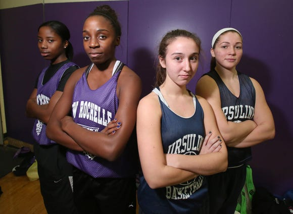 Basketball players Amirror Dixon, left, and Sydney Pinn of New Rochelle and Rianna Peduzzi and Anna Savino of Ursuline pose in the New Rochelle gym Nov. 23, 2013.