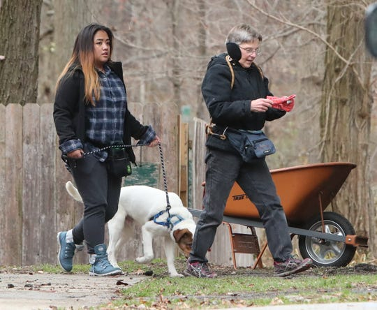Volunteers Jammie Igadna and Roxanne Bullock walk Petey at SPCA of Westchester's facility in Briarcliff Manor Nov. 15, 2018.