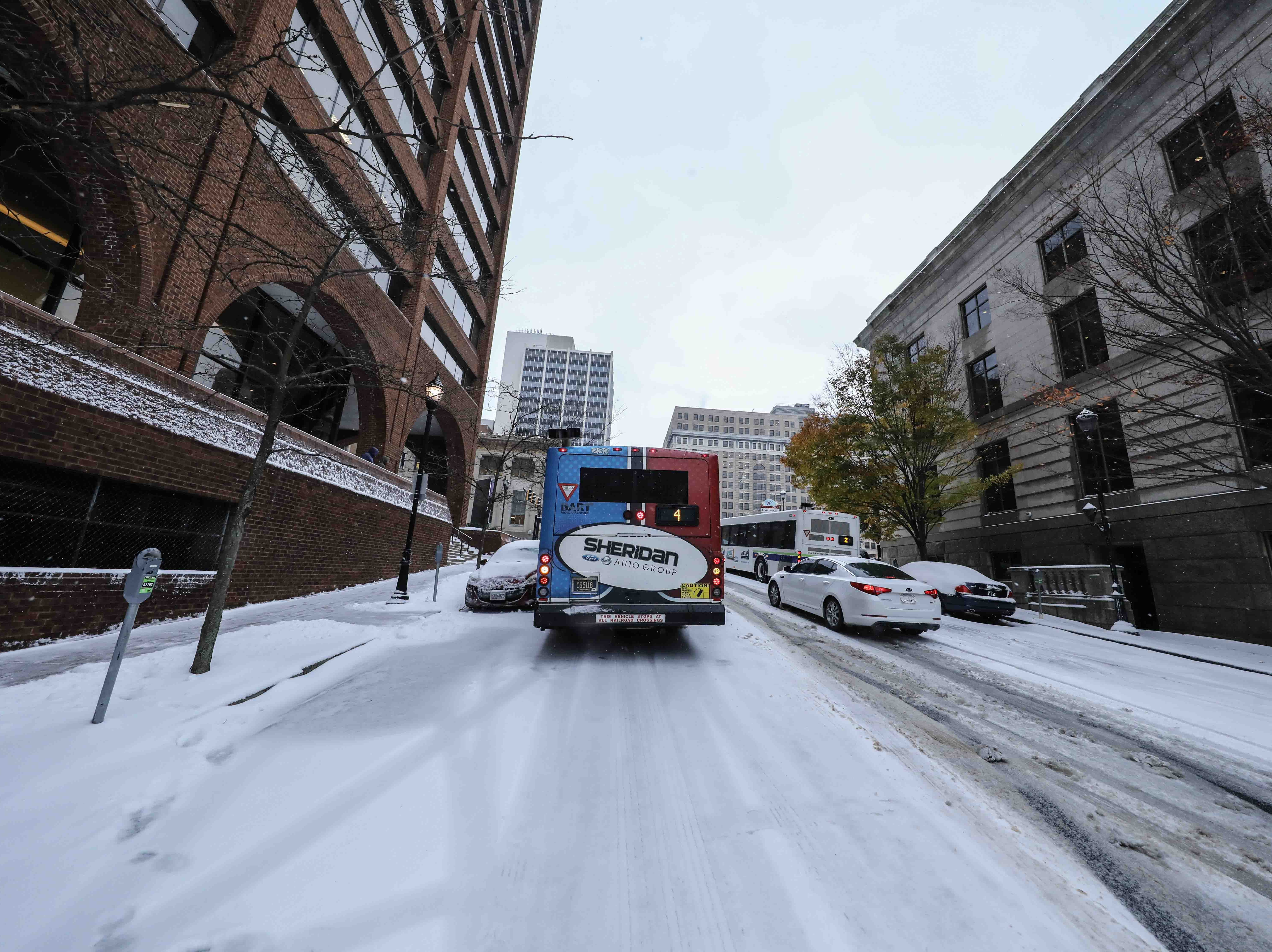 A dart bus slides down the hill of 10th Street between North King and French streets hitting vehicles along the way during heavy snowfall on Thursday, Nov. 15, 2018, in Wilmington.