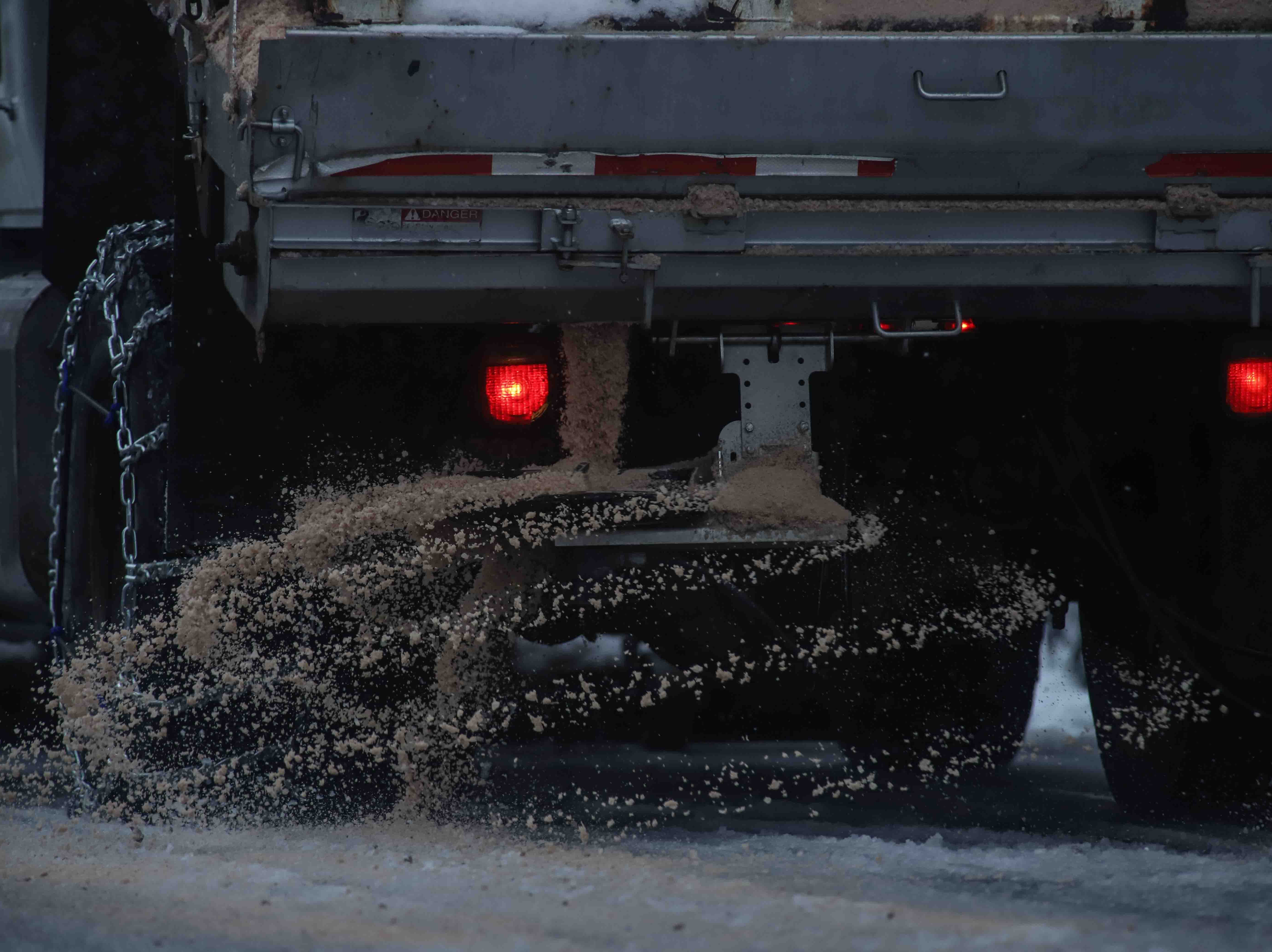 City of Wilmington crews begin to remove snow and put down salt on Market Street during heavy snowfall on Thursday, Nov. 15, 2018, in Wilmington.