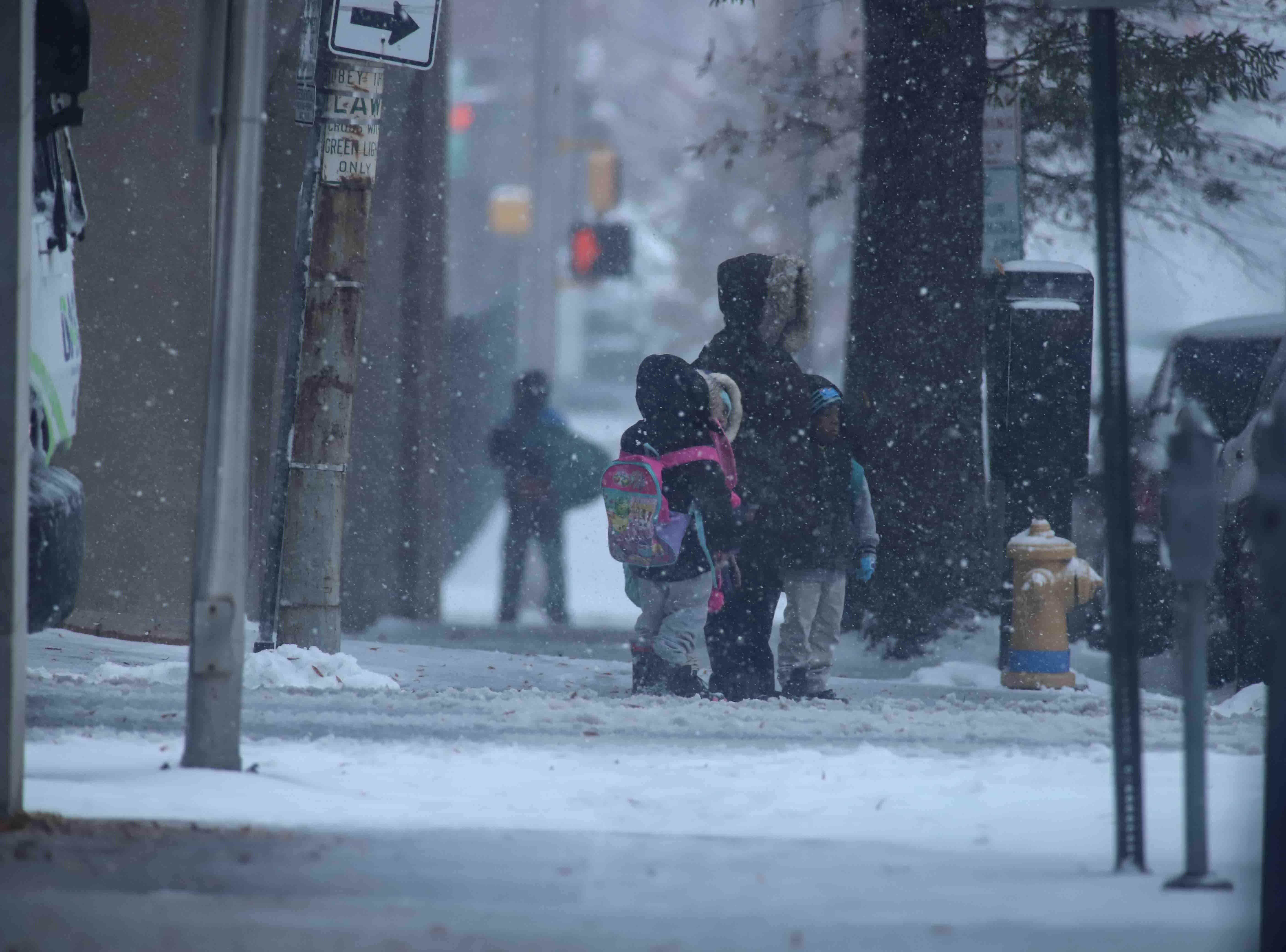 Pedestrians walking down North King Street during heavy snowfall on Thursday, Nov. 15, 2018, in Wilmington.