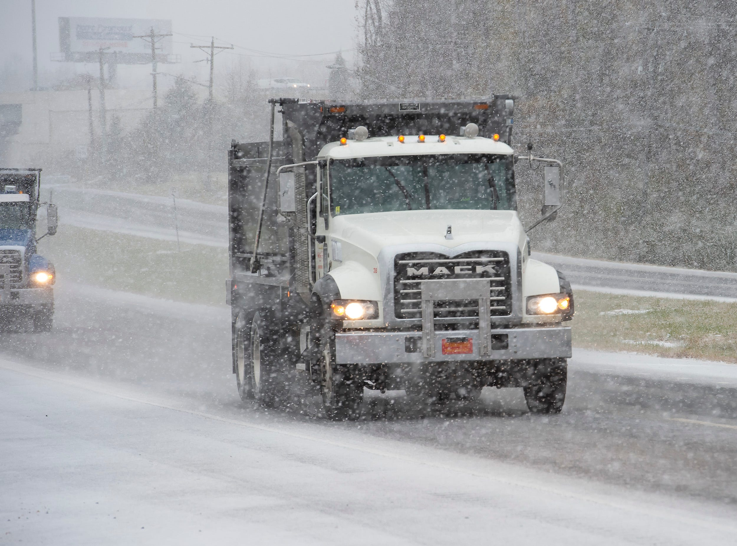 A vehicle travels along Route 13 in Townsend.