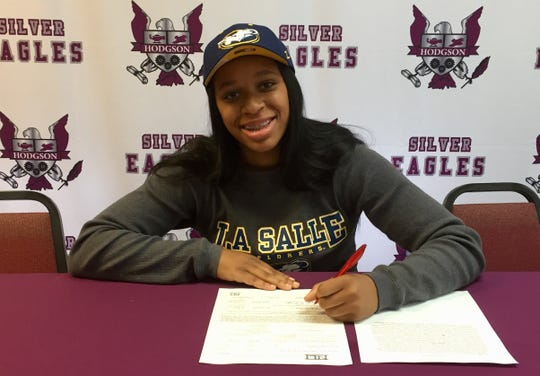 Hodgson's Kayla Braxton-Young, shown here signing a National Letter of Intent with La Salle in November, is the Delaware Online Athlete of the Week for Week 11 of the winter season.