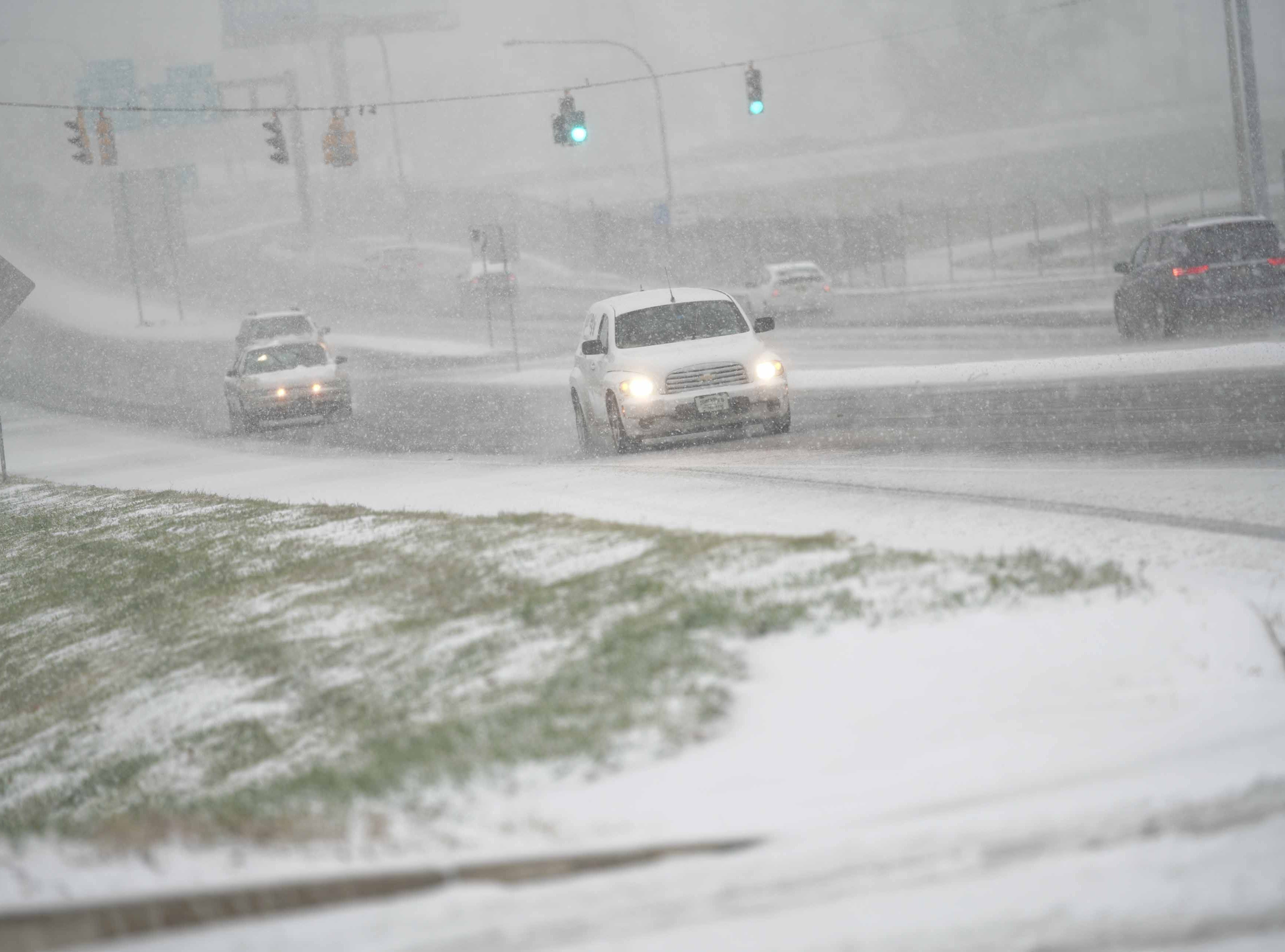 Motorist drive northbound on Rt. 141 on Thursday morning during this years first snow storm.