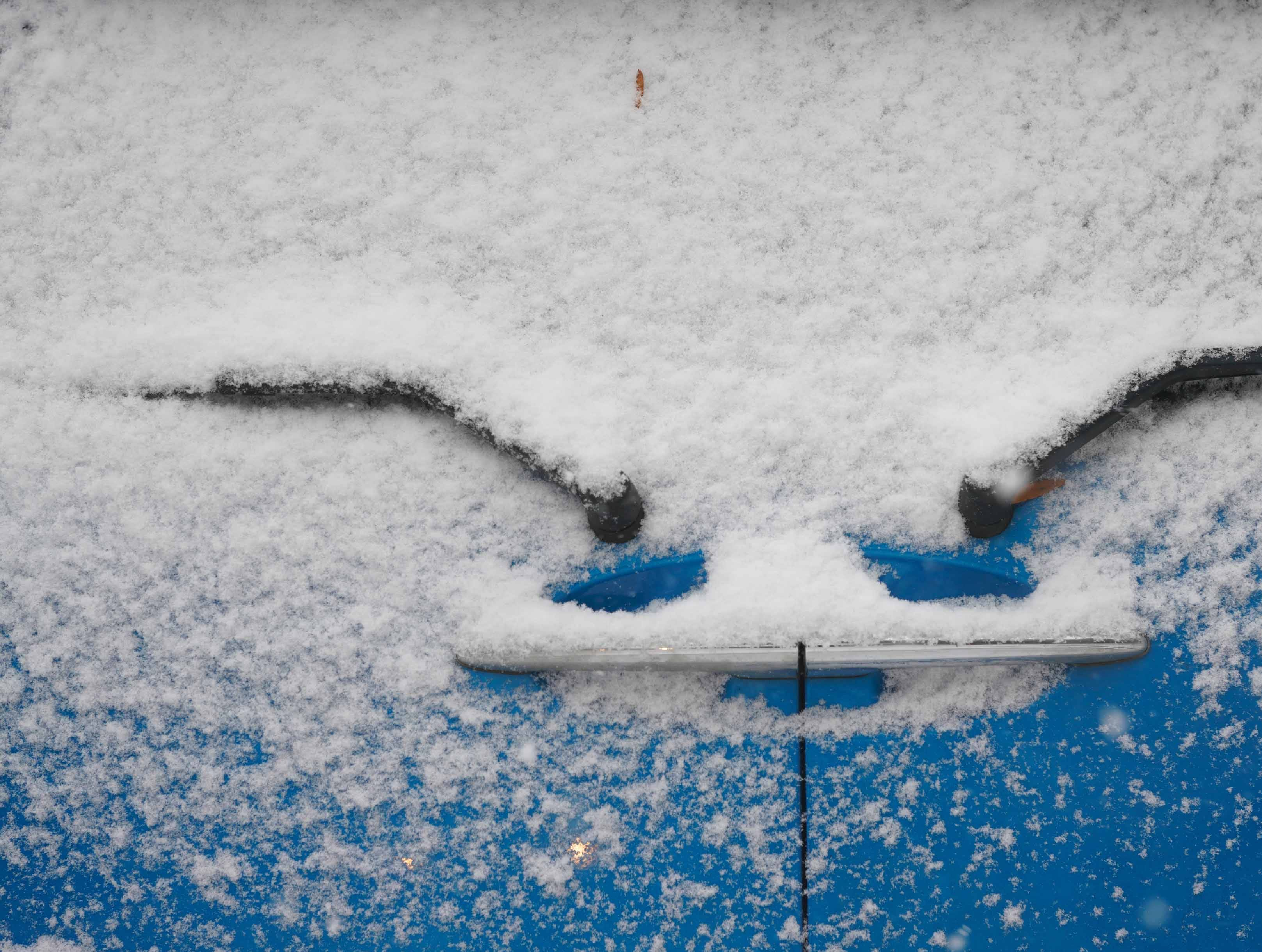 A Mini Cooper got a coating of snow in Old New Castle on Thursday morning.