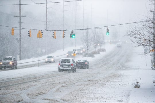 Traffic flows slowly along Lancaster Pike in Hockessin as snow rolls into Delaware and the surrounding area.