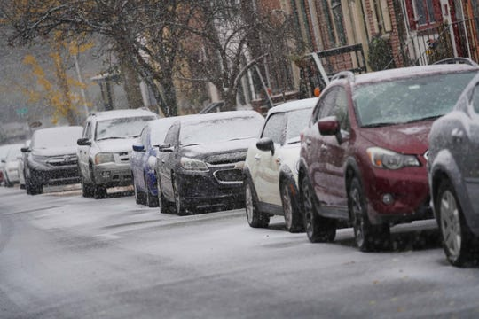 Streets in Old New Castle get a dusting of snow Thursday morning.