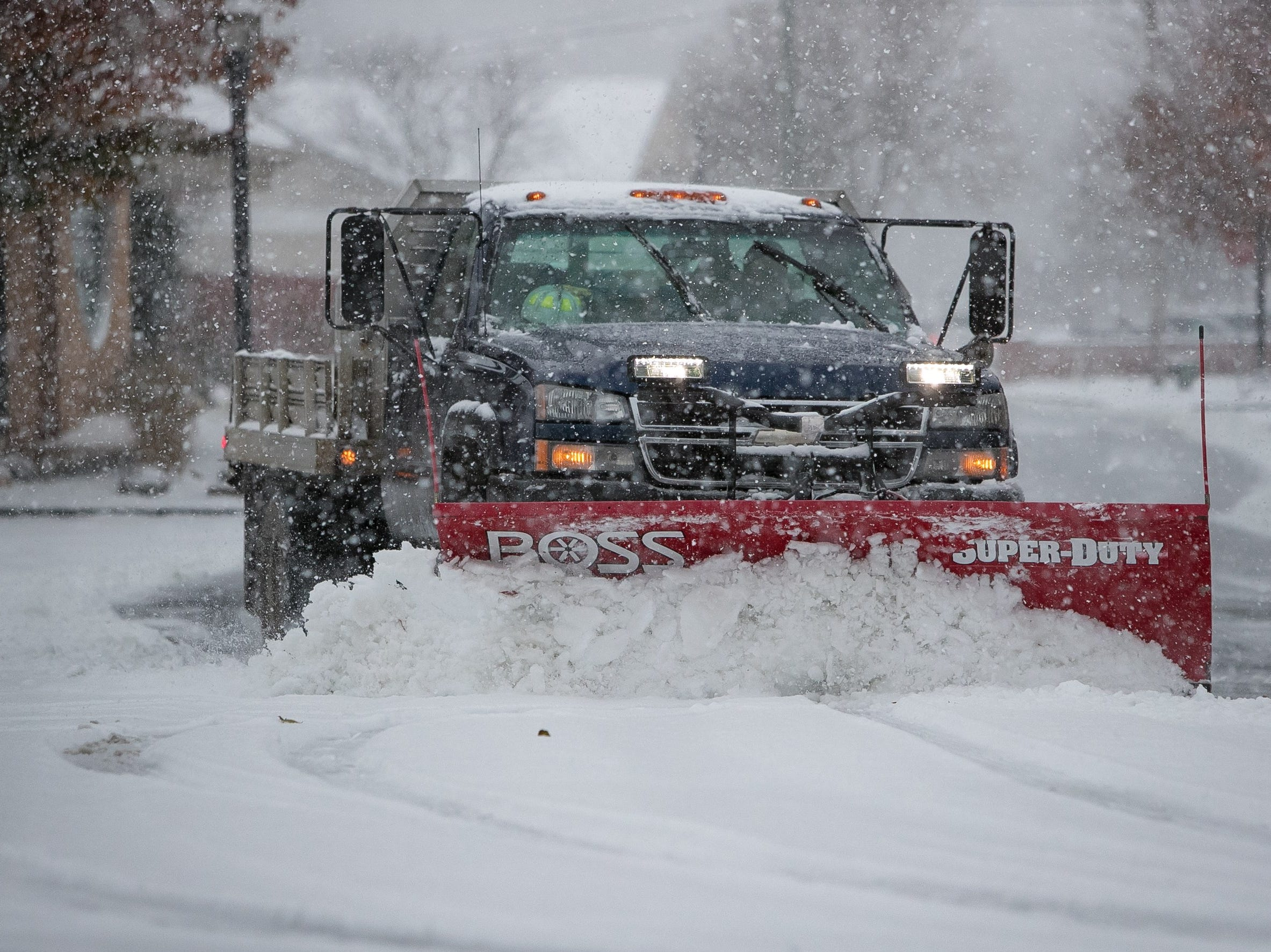 A snow truck clears snow in the parking lot of the Hockessin Fire Hall.