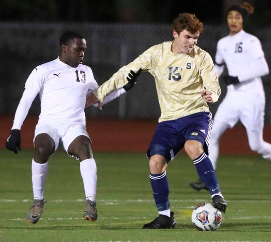 William Penn's Israel Mongare (left) and Salesianum's Andrew Blackwell work at midfield in the second half of Salesianum's 6-0 win in a semifinal of the DIAA Division I state tournament.