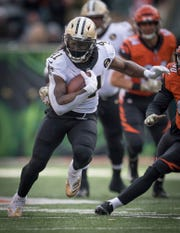 New Orleans Saints running back Alvin Kamara (41) runs with the ball during the first half of an NFL football game against the Bengal in Cincinnati, Oh, Sunday, Nov. 11, 2018. (AP Photo/Bryan Woolston)