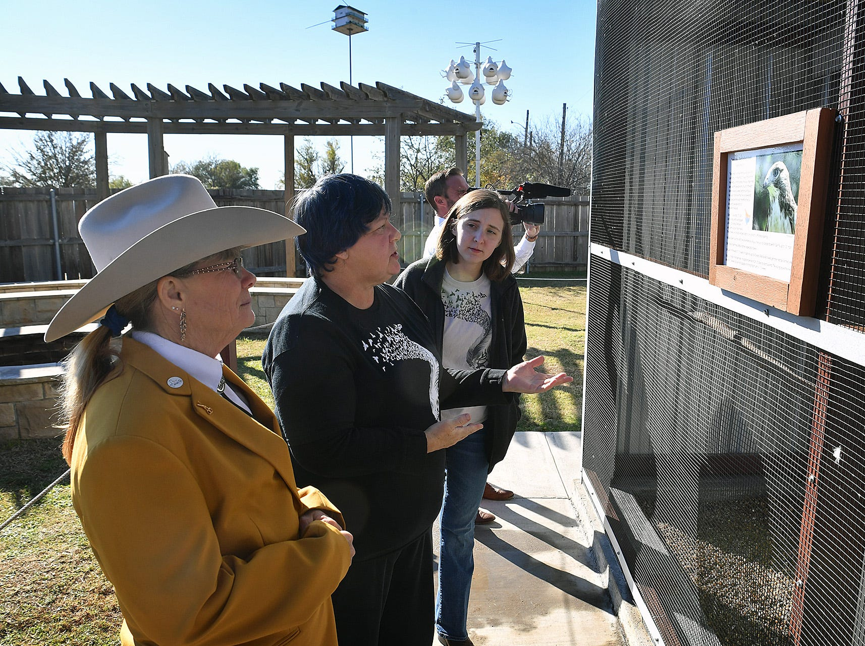 Kathy Richardson, left, tours the new Exhibit and Education building with Connie Palkowetz and Hannah Baer, right, of Wild Bird Rescue Thursday morning.