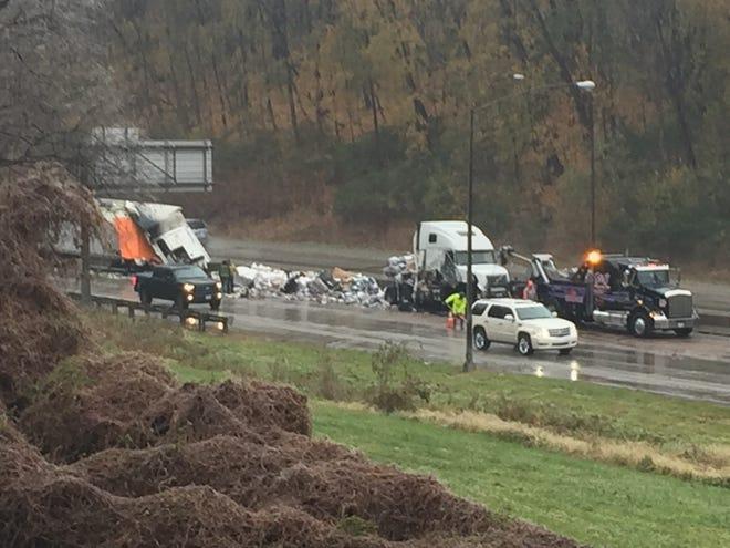 Crews continue to clear the wreckage on I-70 following Thursday morning's fatal accident.