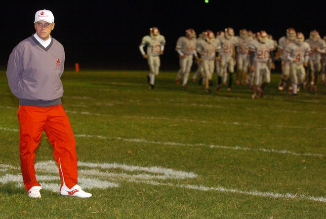 Former Sheridan coach Paul Culver Jr. walks off the field before the start of the second half during a second-round playoff game against Cincinnati Indian Hill in 2005. The Generals won that game, 31-26 at Springfield North High School, to reach the regional finals. Culver's son, Paul III, has the Generals back in the Elite Eight this season with plenty of his dad's influence.
