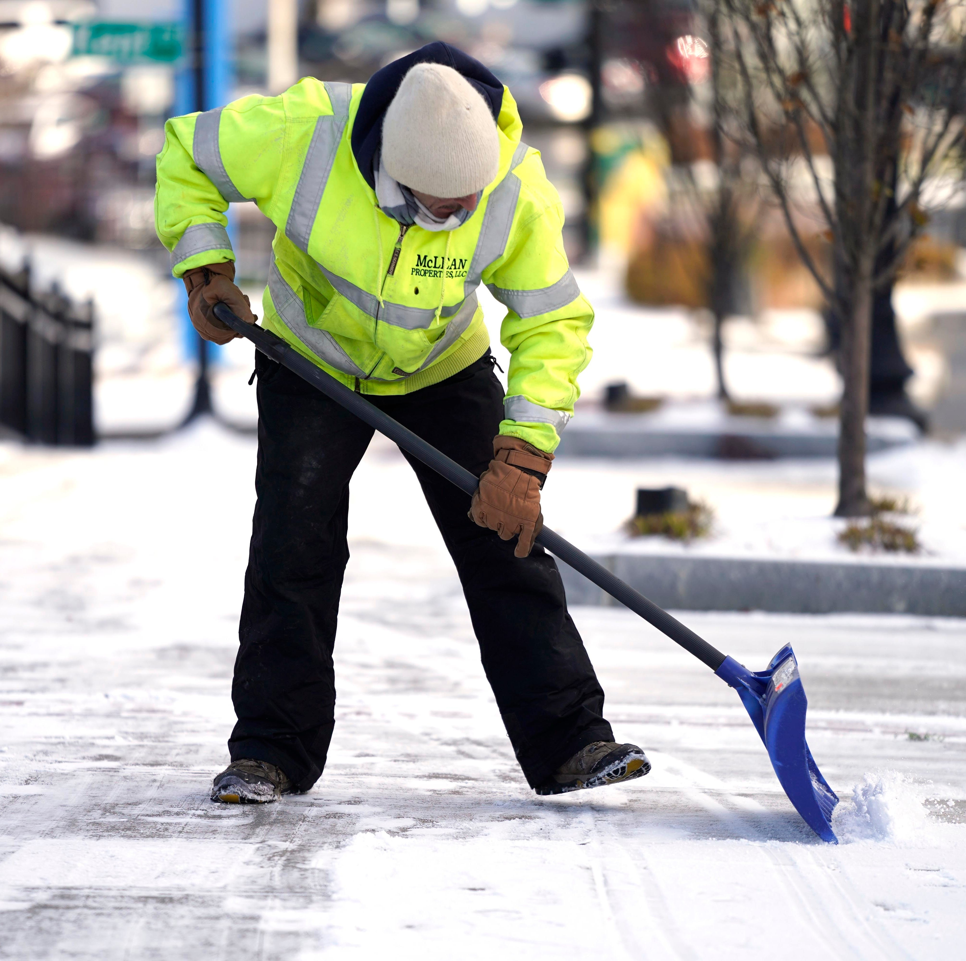 Phill Levey shovels the sidewalk on North Street in Pittsfield, Mass., after the first snow of the season Wednesday.