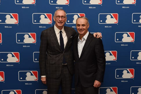 John Skipper, DAZN Group Executive Chairman. and MLB Commissioner Rob Manfred, Jr., at right, on Nov. 15 in Atlanta.  A new three-year deal will allow the streaming service to broadcast a nightly live highlights show.