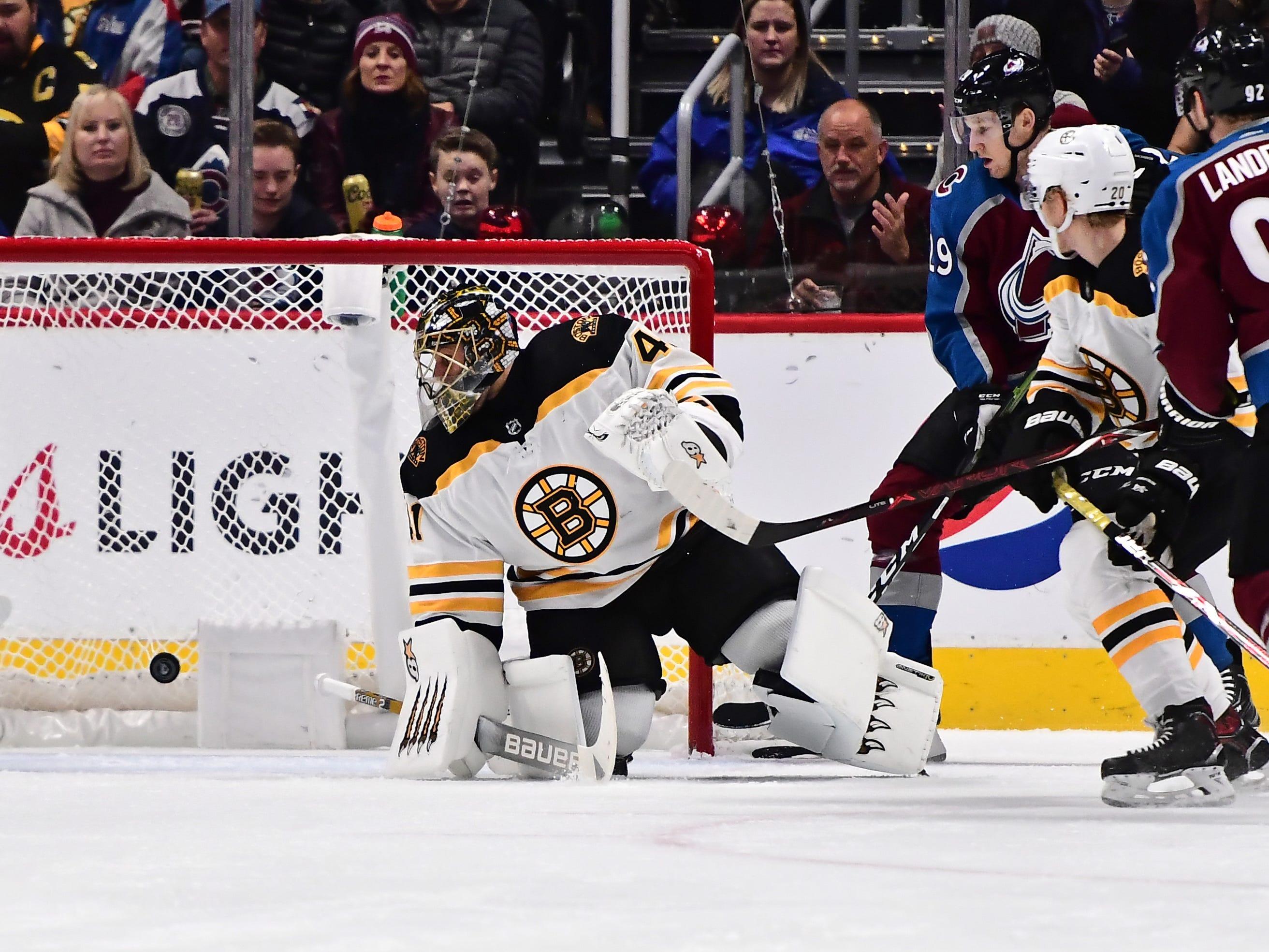 Nov. 14: Boston Bruins goaltender Jaroslav Halak watches as Colorado Avalanche captain Gabriel Landeskog's shot goes into the net.