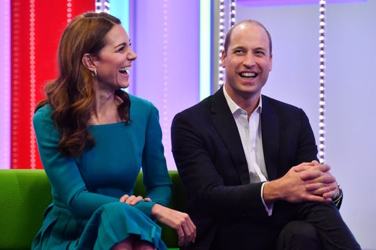 Prince William and Duchess Kate laugh as they visit BBC Broadcasting House on November 15, 2018 in London, England. The Royal couple came to view the work the broadcaster is doing as a member of The Duke's Taskforce on the Prevention of of Cyberbullying.