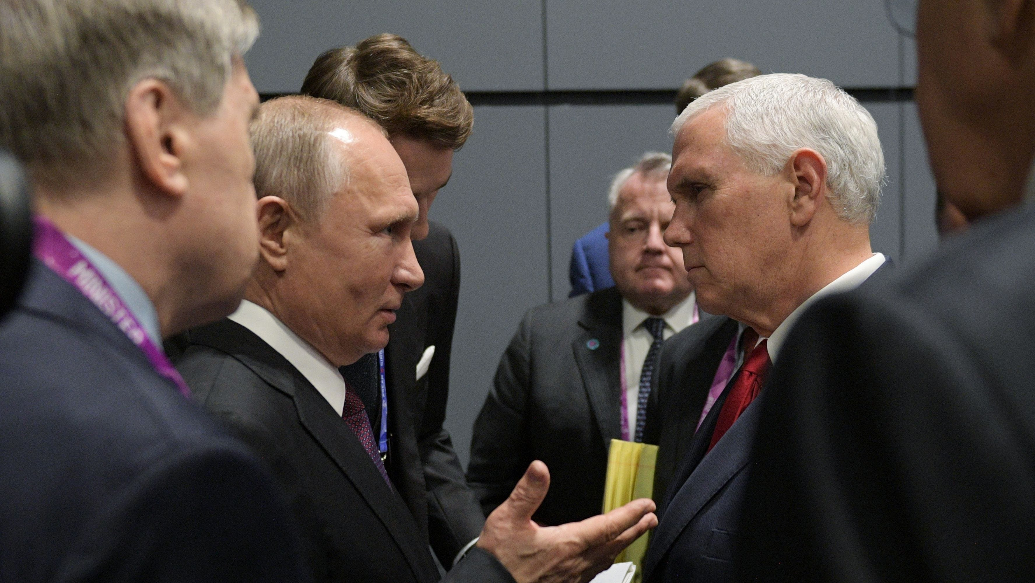 Vice President Mike Pence and Russian President Vladimir Putin in Singapore.