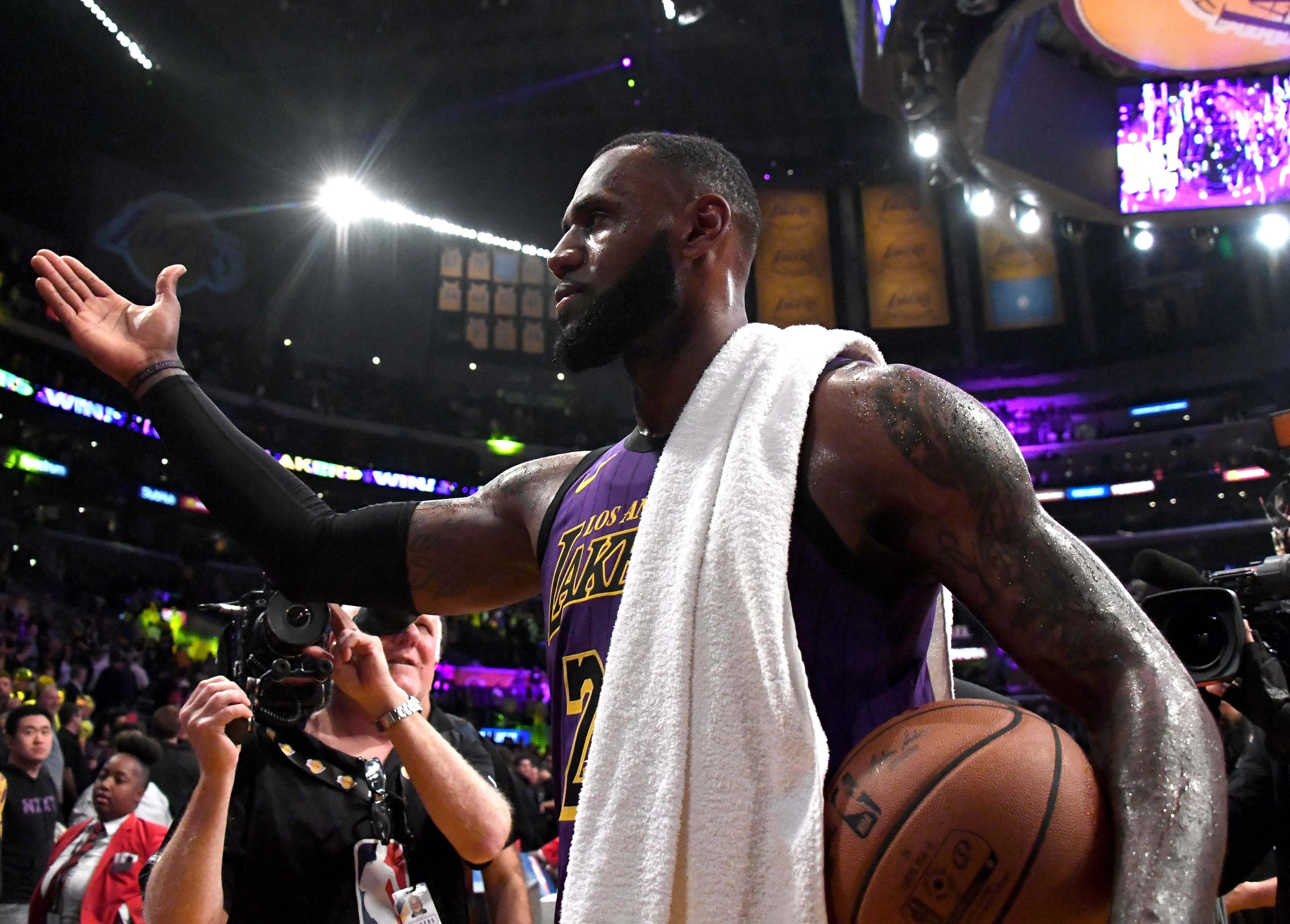 Nov. 14, 2018: LeBron James walks off the  court with the game ball after passing Wilt Chamberlain to move into fifth on the NBA's all-time career scoring list.