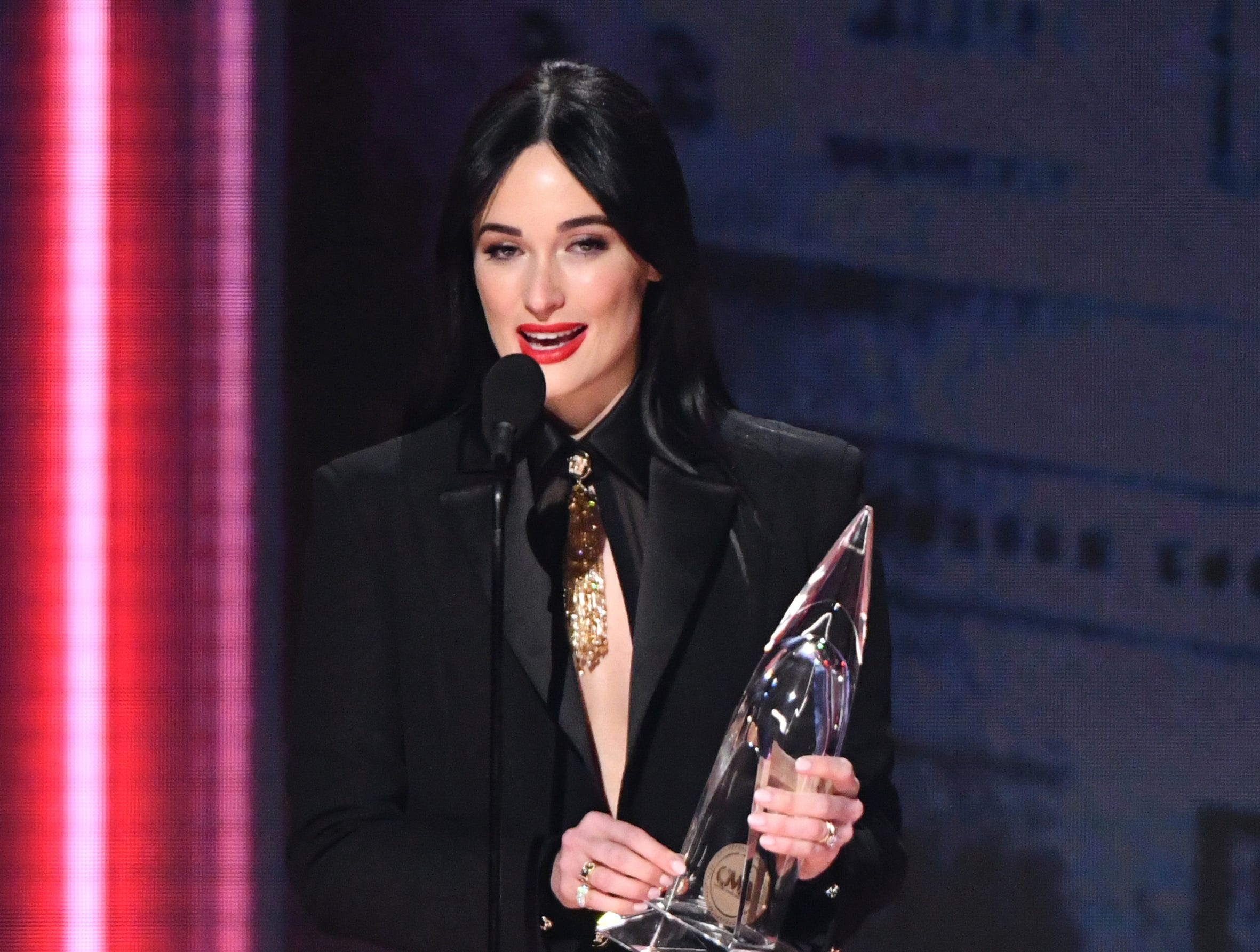"Kacey Musgraves? accepts the award for album of the year for ""Golden Hour"" at the 52nd annual CMA Awards at Bridgestone Arena on Wednesday, Nov. 14, 2018, in Nashville, Tenn. (Photo by Charles Sykes/Invision/AP) ORG XMIT: TNAK267"