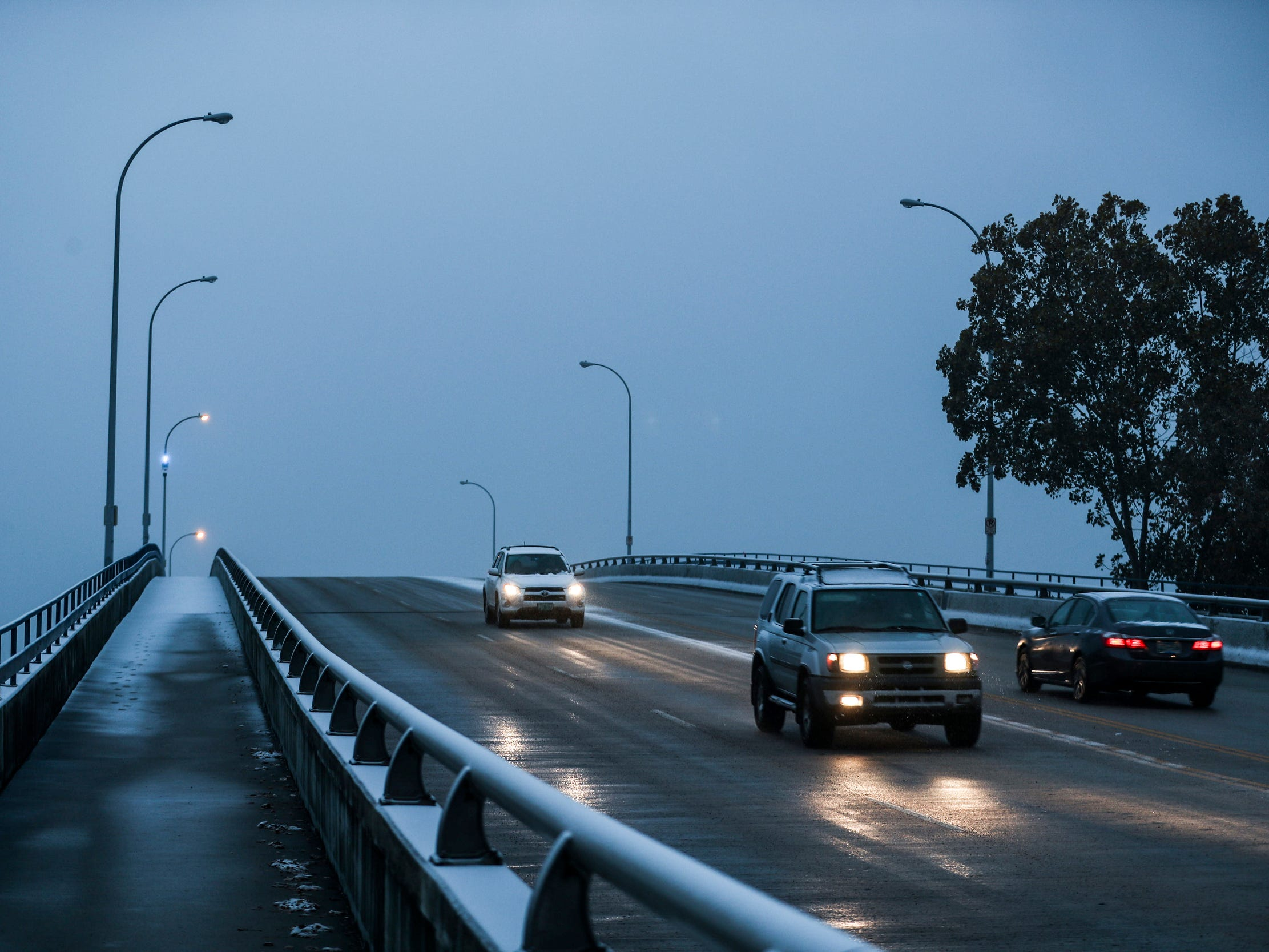 Traffic moves along on the A. W. Willis bridge in Memphis, Tenn., Wednesday, Nov. 14, 2018, during Wednesday's winter weather.