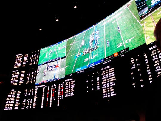 This Sept. 9, 2018, photo shows betting boards and video screens inside the sports betting lounge at the Ocean Resort Casino in Atlantic City, N.J.