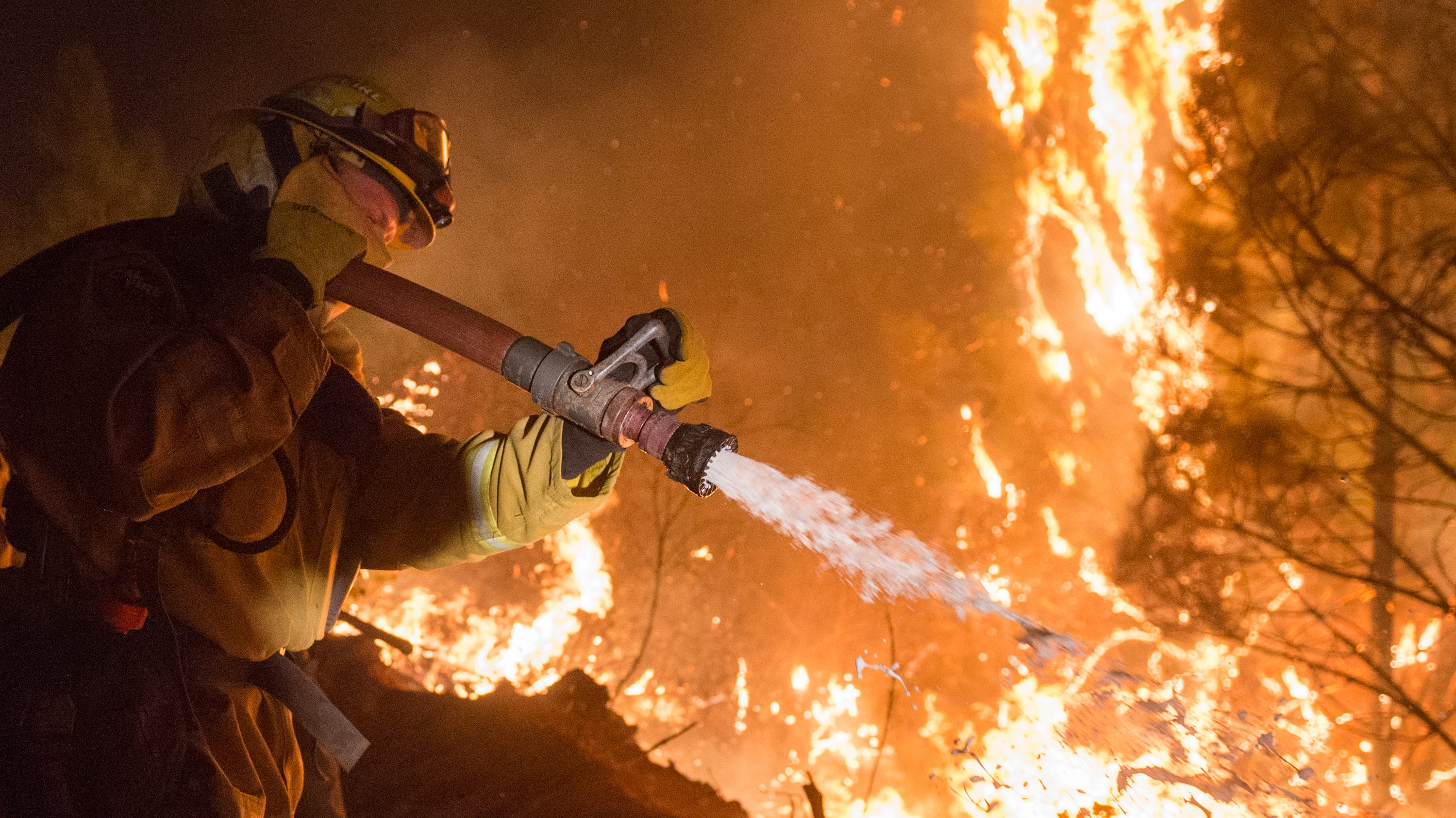 Firefighters work to control the Camp Fire north of Oroville, Calif., Wednesday, Nov. 14, 2018.