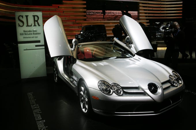 A videographer films a Mercedes-Benz SLR McLaren Roadstar at the North American International Auto Show on Jan. 14, 2008, in Detroit.