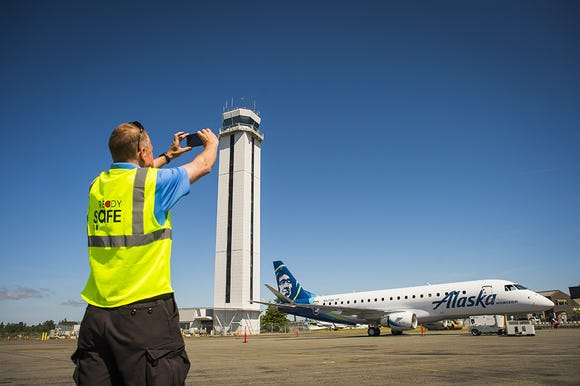This photo provided by Alaska Airlines shows an Embraer E175 of affiliate Horizon Air at Paine Field in Everett, Washington.