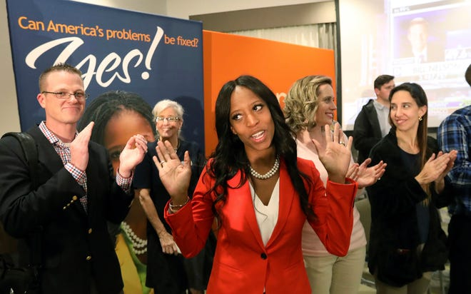 Rep. Mia Love, R-Utah, greets supporters during an election night party, in Lehi, Utah.