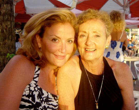 Erika Byrd, who died in 2011 due to alcohol, is shown with her mother June Byrd in Waikiki Beach at sunset in Hawaii in 2003.