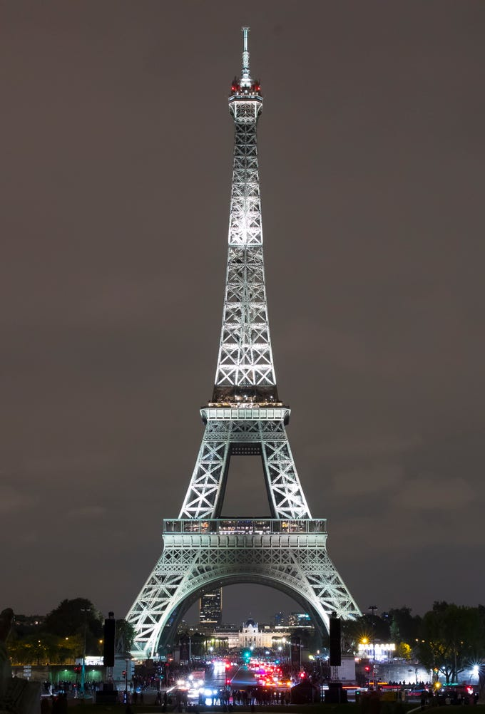The Eiffel Tower in Paris, France. Taking pictures of the Tower at night when its lights glow isn't a good idea. It's protected by a copyright law, which means selling it or even sharing it on social media without permission could lead to a fine.