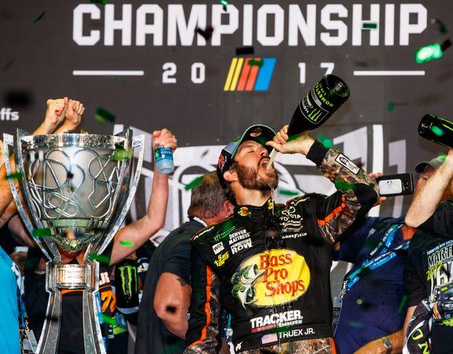 Martin Truex Jr. celebrates after winning the 2017 Monster Energy NASCAR Cup Series championship.