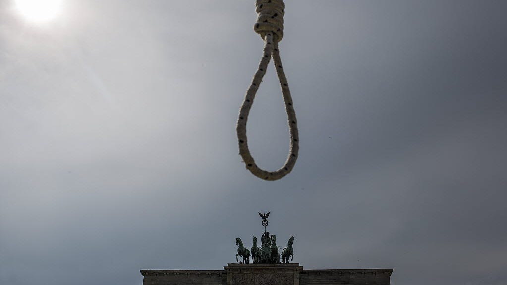 A noose hung up by Iranians living in exile in Germany is seen during a protest against Iranian policy in Iran and Syria regarding executions and stoning in front of the landmark Brandenburg Gate in Berlin in 2014.
