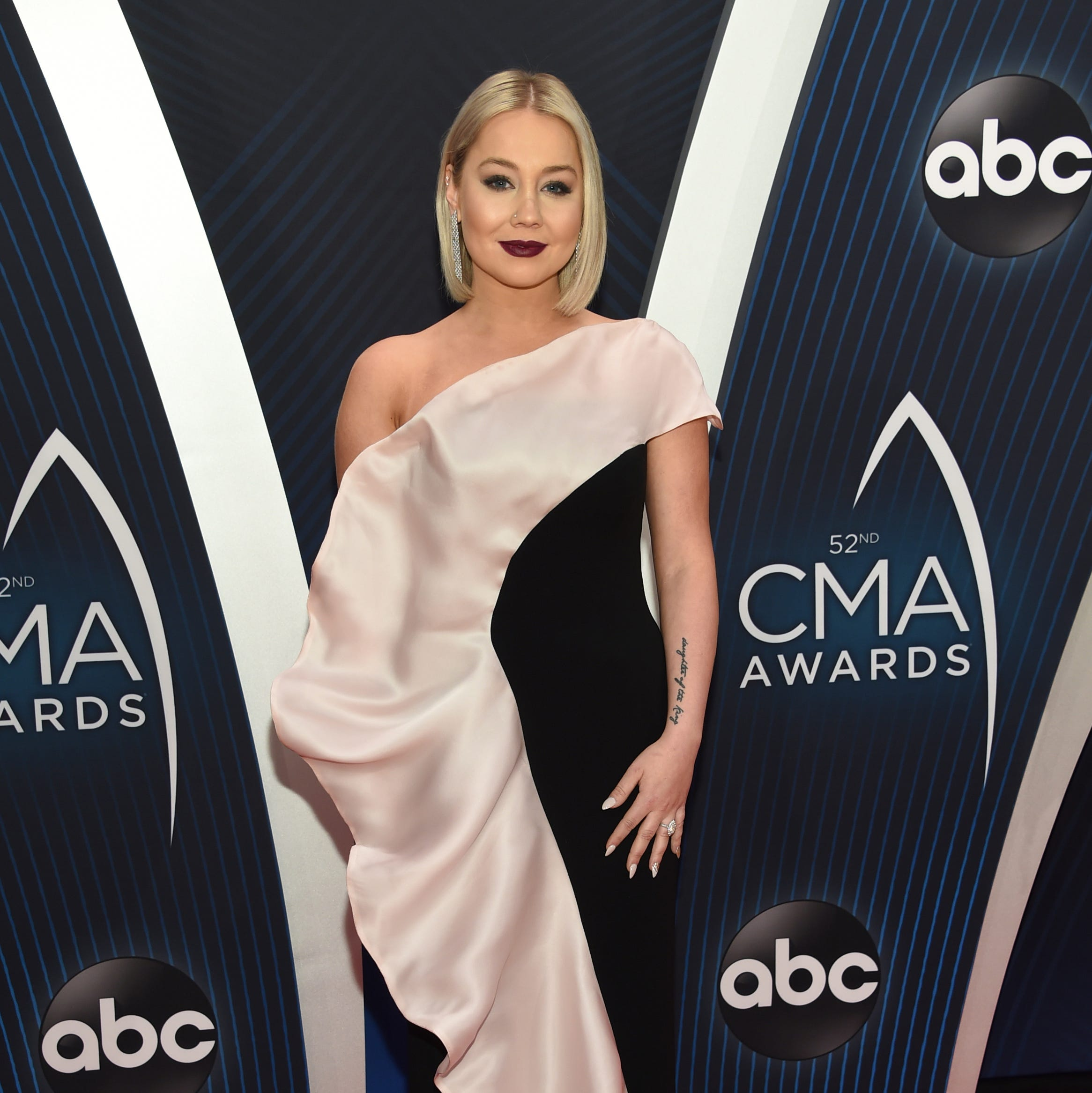 RaeLynn arrives at the 52nd annual CMA Awards at Bridgestone Arena on Wednesday, Nov. 14, 2018, in Nashville, Tenn.
