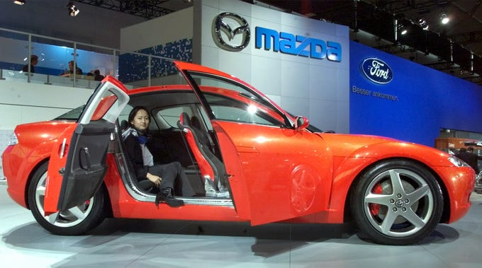A Mazda RX-8 sports car that made its show debut at the international motor show in Frankfurt, Germany on Sept.12, 2001. The RX-8 is a four-seater that comes with a freestyle door system without center pillar for easy entry and exit and a rotary engine.