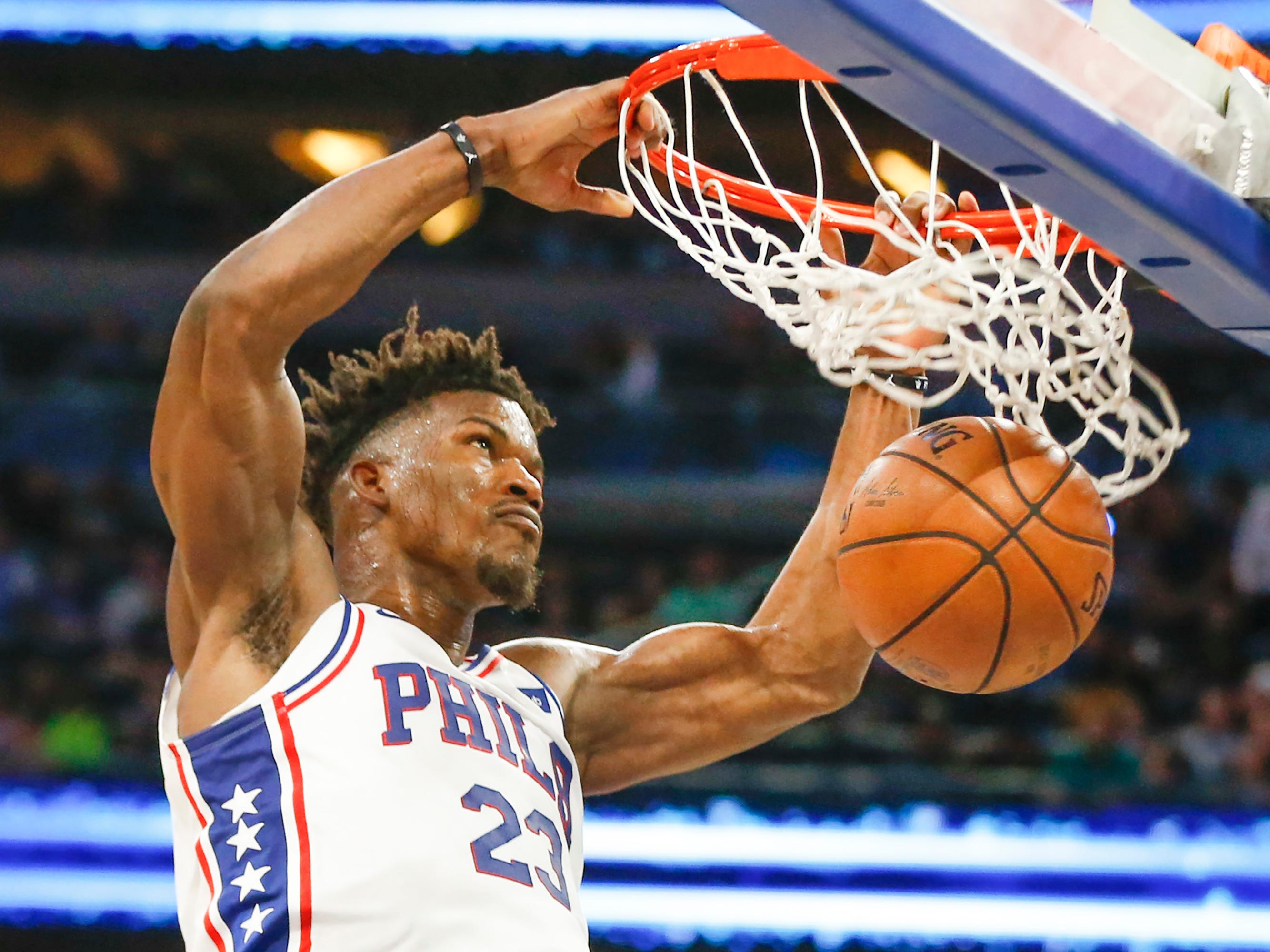 Nov. 14: 76ers guard Jimmy Butler throws down a two-handed flush during the second half against the Magic in Orlando.