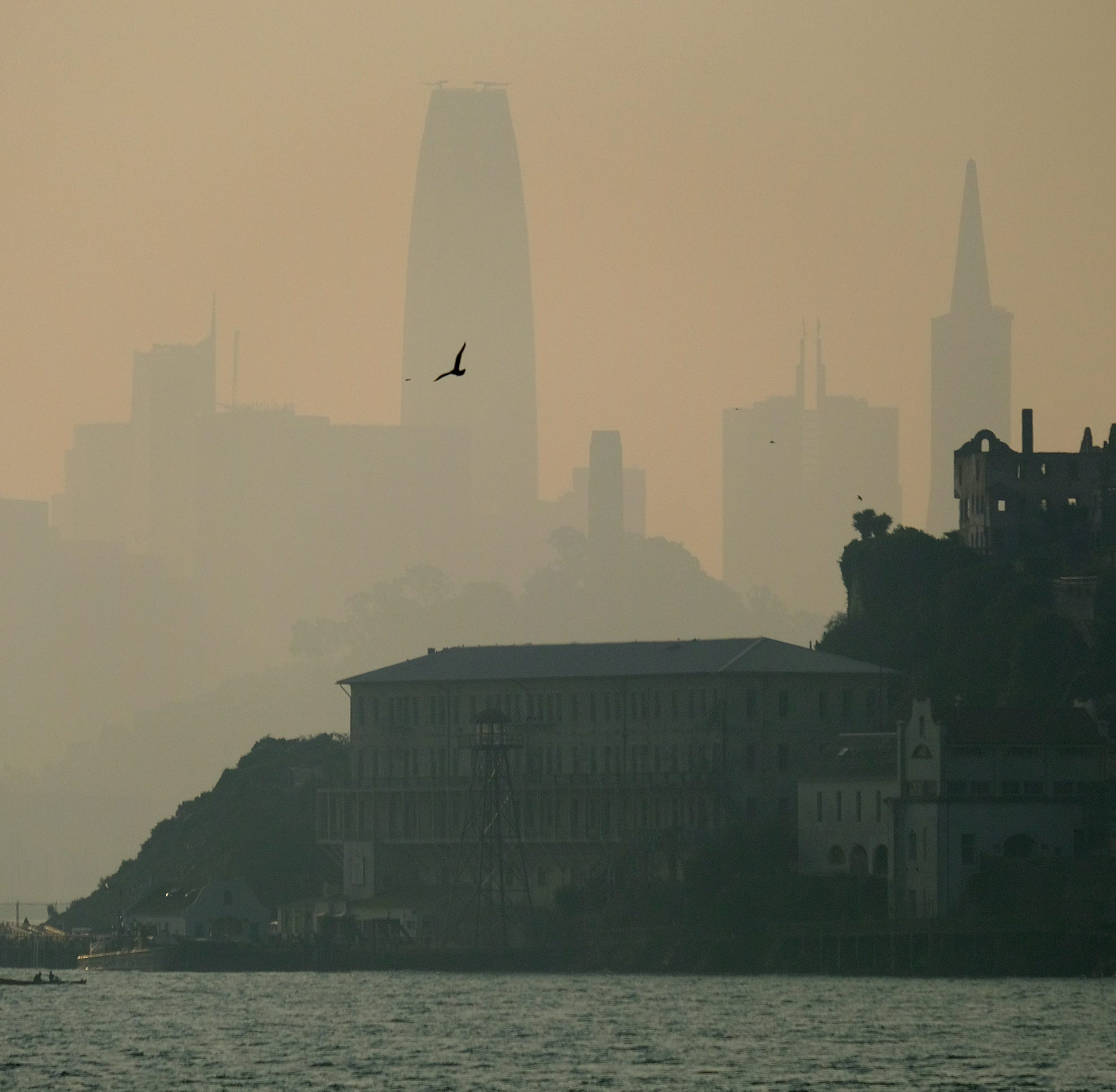 The San Francisco skyline is obscured by smoke and haze from wildfires behind Alcatraz Island Wednesday, Nov. 14, 2018, in San Francisco.