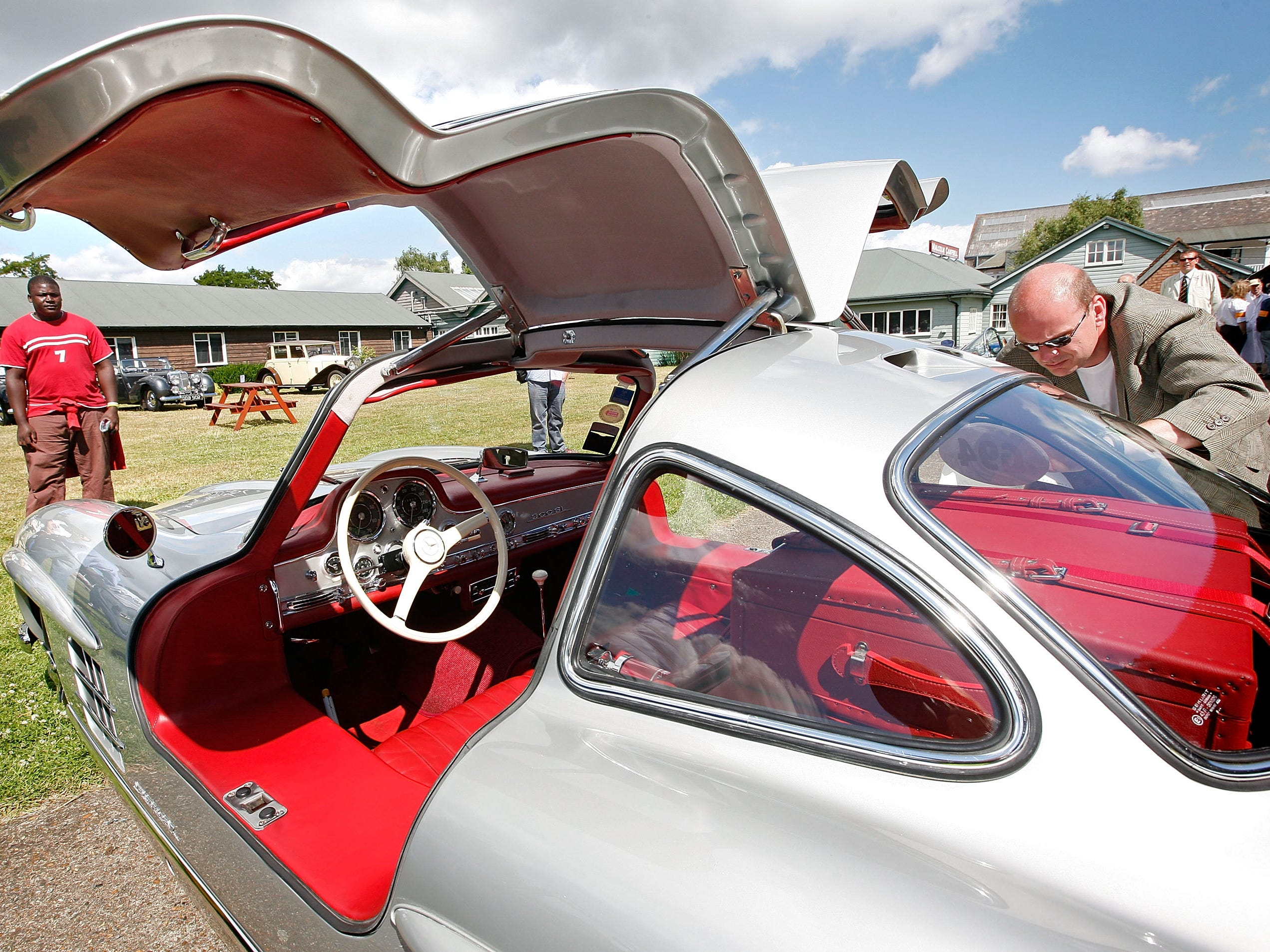 A man places the racing number on a 1955 Mercedes-Benz 300SL Gullwing at the Brooklands Motoring Festival 2008, 'The Double Twelve' on June 28, 2008, in Weybridge, England.