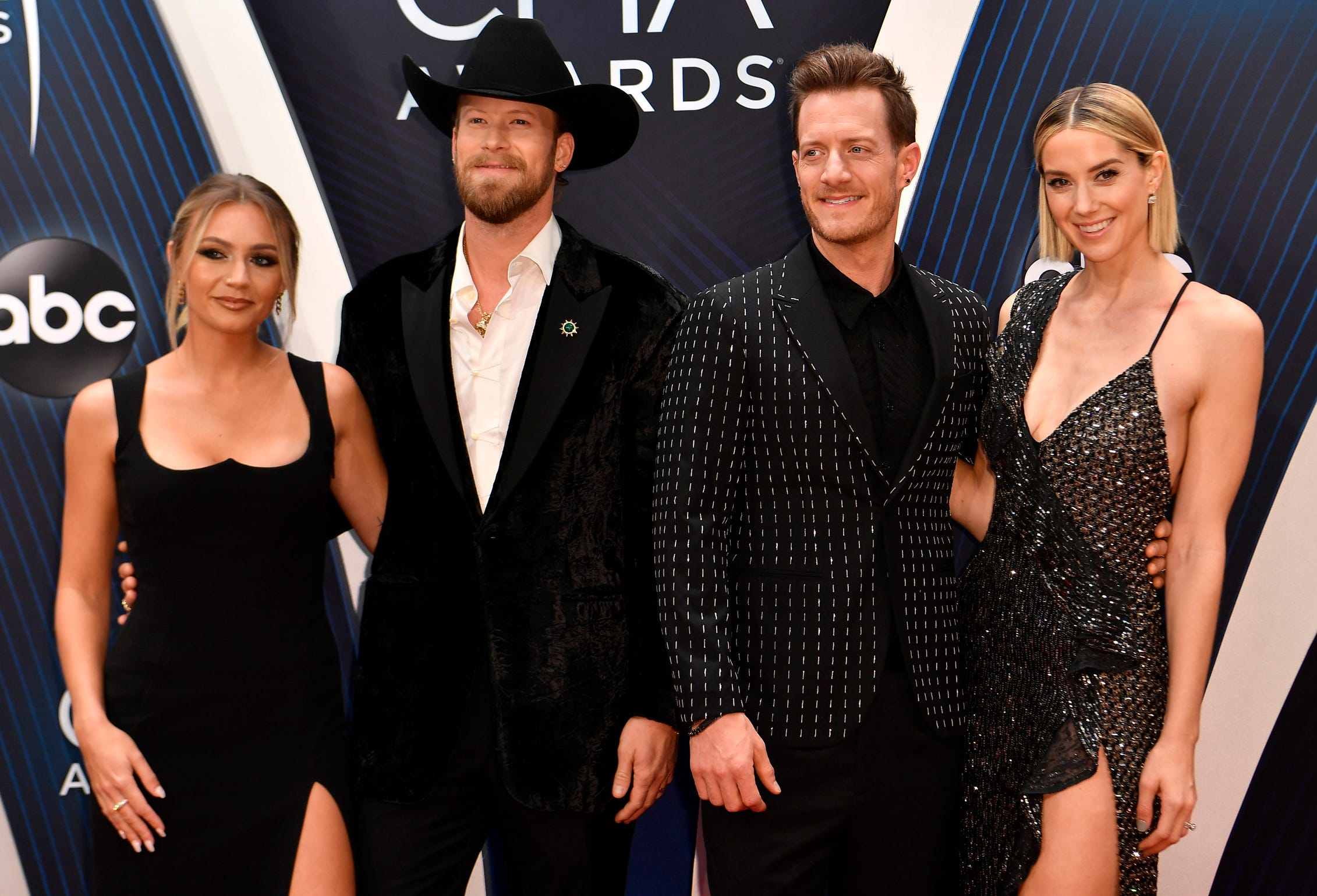 Country music's biggest stars turned up the fashion heat on the red carpet for the 52nd Annual Country Music Association Awards in Nashville. Click ahead to see the hottest looks.   Florida Georgia Line arrives  before the 52nd Annual CMA Awards at Bridgestone Arena.