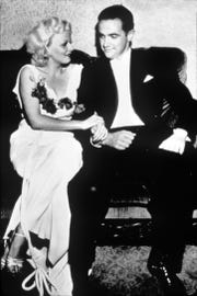 Howard Hughes with actress Jean Harlow in an undated photo. A new book looks at Hughes' controlling relationships with Hollywood women.
