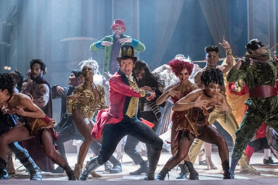 P.T. Barnum (Hugh Jackman, center) creates a family of circus stars out of society's outcasts in the musical 'The Greatest Showman.'
