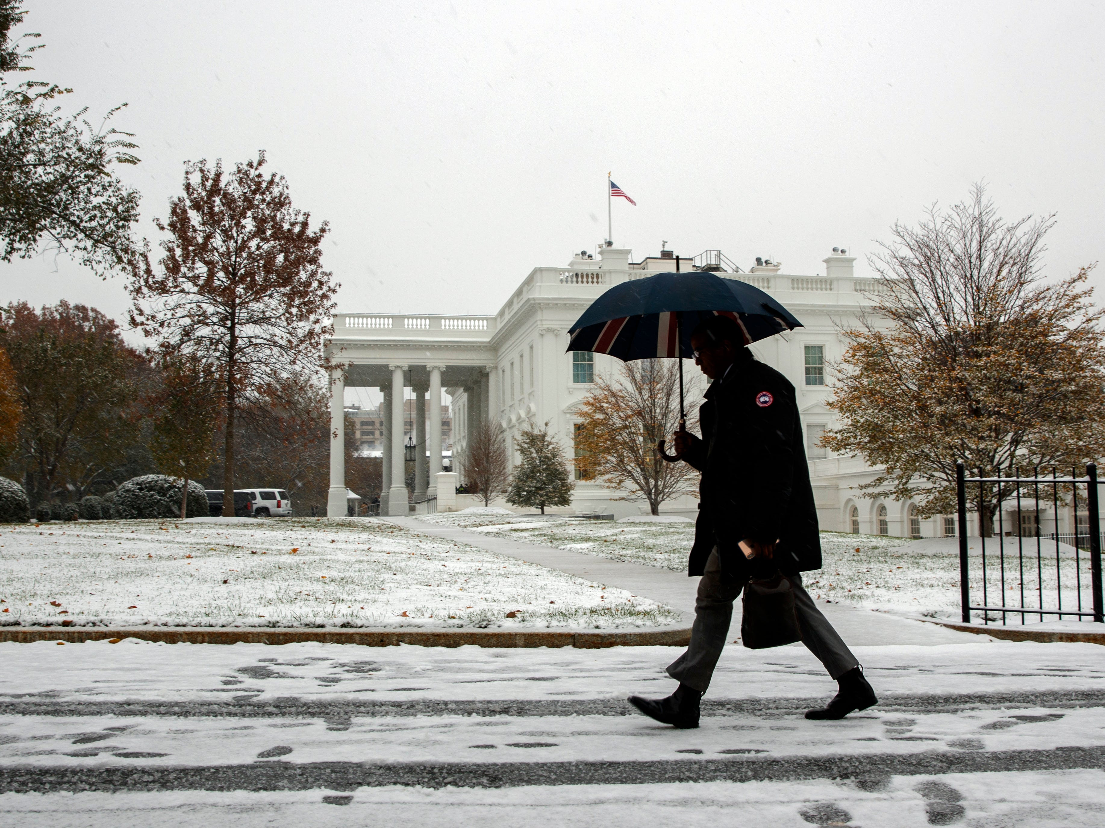 Snow falls on the White House, Thursday, Nov. 15, 2018, in Washington.