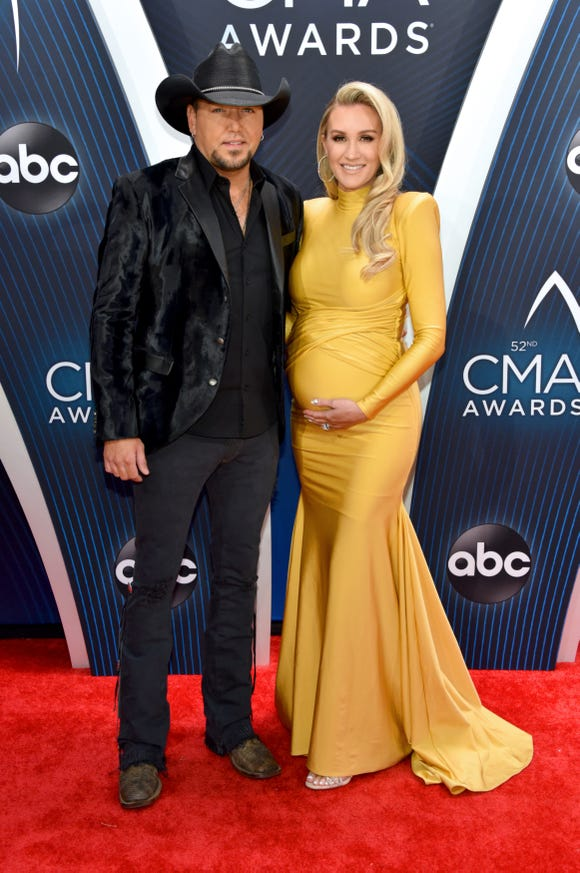 Singer-songwriter Jason Aldean and wife Brittany Kerr attend the 52nd annual CMA Awards in style.