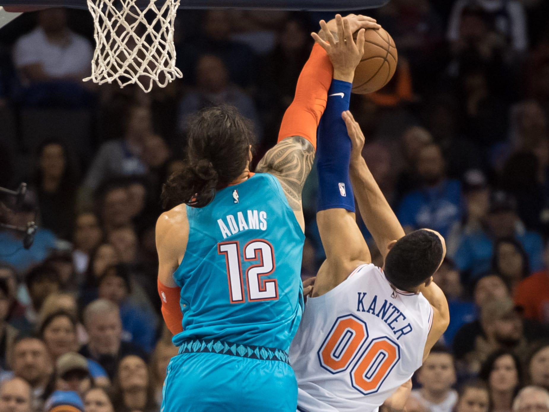 Nov. 14: Thunder center Steven Adams (12) blocks a shot attempt by Knicks center Enes Kanter (00) during the second half in Oklahoma City.